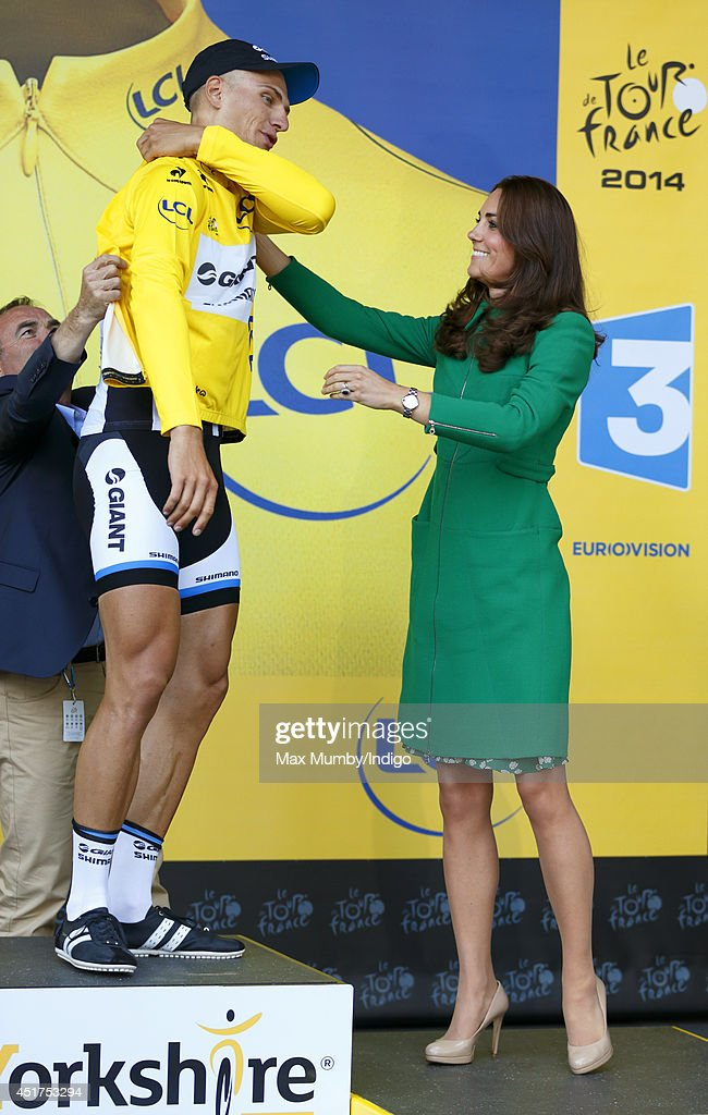 Catherine, Duchess of Cambridge presents Marcel Kittel with the yellow jersey after he won stage one of the Tour de France on July 5, 2014 in Harrogate, England.