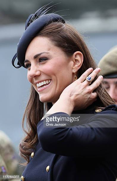 Catherine, Duchess of Cambridge presents medals to members of the Irish Guards at the Victoria Barracks on June 25, 2011 in Windsor, England. The...