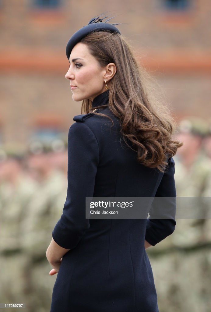 Catherine, Duchess of Cambridge presents medals to members of the Irish Guards at the Victoria Barracks on June 25, 2011 in Windsor, England. The Duchess of Cambridge and Duke of Cambridge are at the barracks to present service medals to members of the Irish Guards