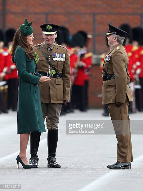 Catherine Duchess of Cambridge presents 'Shamrocks' during the St Patrick's Day parade at Mons Barracks on March 17 2014 in Aldershot England...