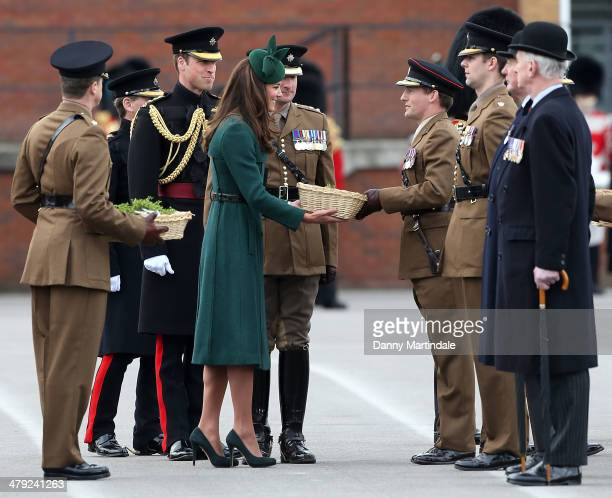 Catherine, Duchess of Cambridge presents 'Shamrocks' during the St Patrick's Day parade at Mons Barracks on March 17, 2014 in Aldershot, England....