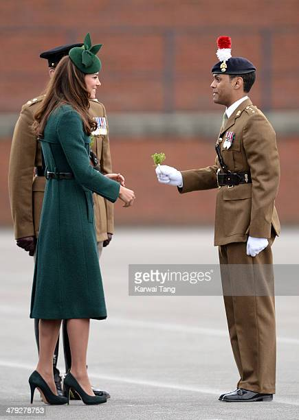 Catherine Duchess of Cambridge presents 'Shamrocks' during the St Patrick's Day parade at Mons Barracks on March 17 2014 in Aldershot England