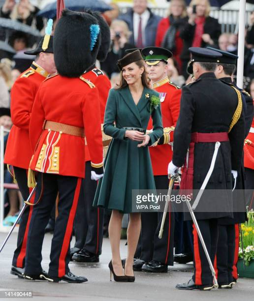 Catherine Duchess of Cambridge presents shamrocks to members of the 1st Battalion Irish Guards at the St Patrick's Day Parade at Mons Barracks on...