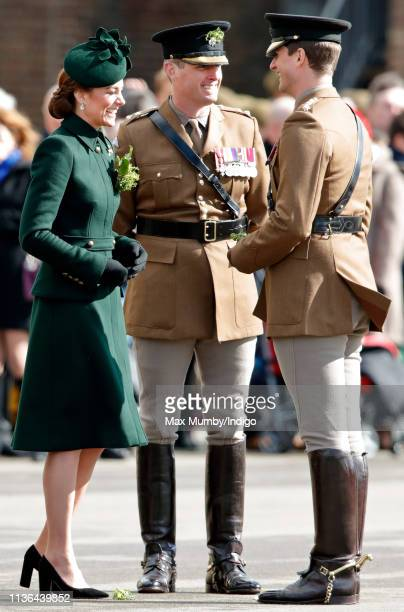 Catherine Duchess of Cambridge presents shamrocks to soldiers of the 1st Battalion Irish Guards during the St Patrick's Day Parade at Cavalry...