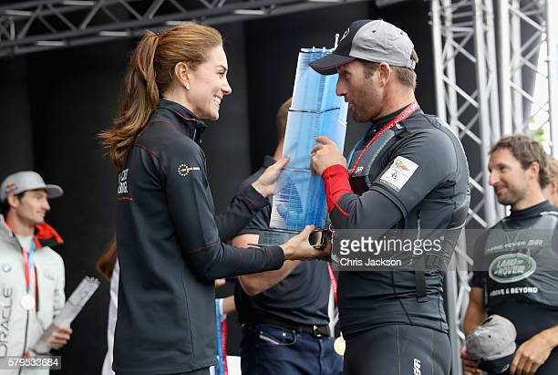 Catherine, Duchess of Cambridge presents Sir Ben Ainslie with the America's Cup 2016 trophy on stage at the America's Cup World Series on July 24,...