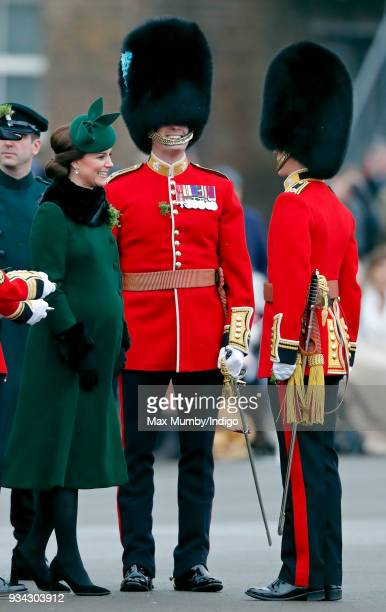 Catherine, Duchess of Cambridge presents sprigs of shamrock to soldiers of 1st Battalion Irish Guards during the annual Irish Guards St Patrick's Day...