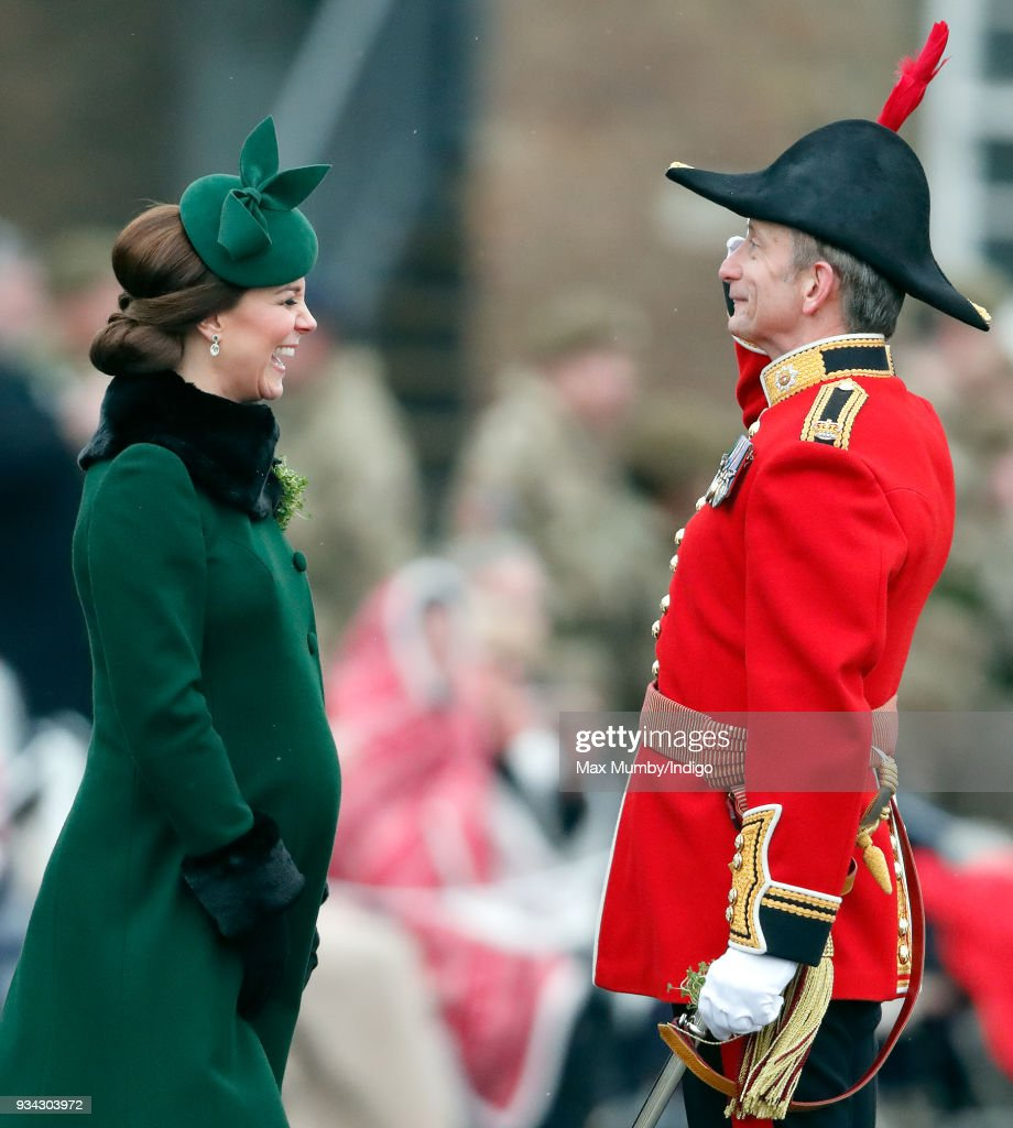 Catherine, Duchess of Cambridge presents sprigs of shamrock to soldiers of 1st Battalion Irish Guards during the annual Irish Guards St Patrick's Day Parade at Cavalry Barracks on March 17, 2018 in Hounslow, England.