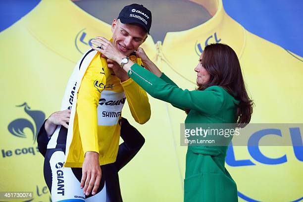 Catherine, Duchess of Cambridge presents stage winner Marcel Kittel of Germany and Giant Shimano with his yellow jersey after stage one of the 2014...