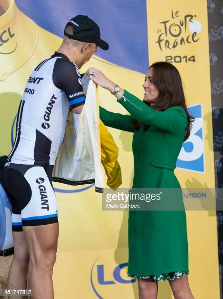 Catherine Duchess of Cambridge presents the yellow jersey to winner Marcel Kittel at the finish line of stage one of The Tour de France on July 5...