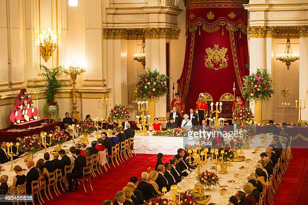Catherine, Duchess of Cambridge, President of China Xi Jinping and Prince Philip, Duke of Edinburgh listen to Britain's Queen Elizabeth II speaks...