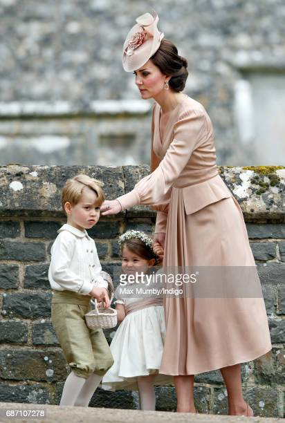Catherine Duchess of Cambridge Prince George of Cambridge and Princess Charlotte of Cambridge attend the wedding of Pippa Middleton and James...