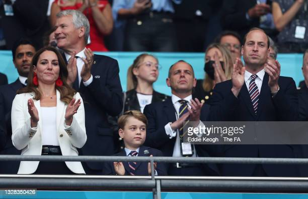 Catherine, Duchess of Cambridge, Prince George of Cambridge and Prince William, Duke of Cambridge and President of the Football Association applaud...