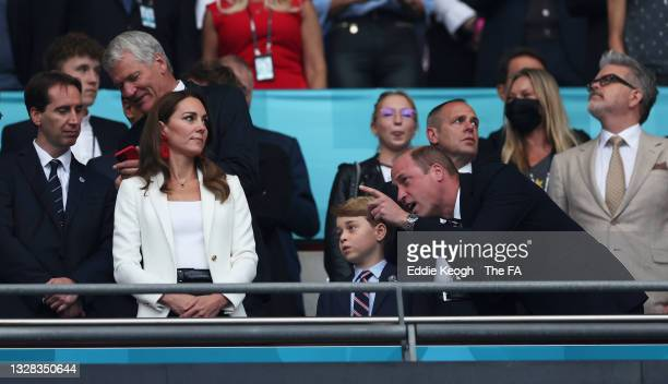 Catherine, Duchess of Cambridge, Prince George of Cambridge and Prince William, Duke of Cambridge and President of the Football Association look on...