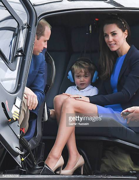 Catherine Duchess of Cambridge Prince George of Cambridge and Prince William Duke of Cambridge sit in a helicopter as they attend the The Royal...