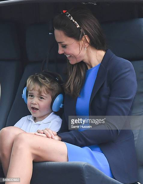 Catherine Duchess of Cambridge Prince George of Cambridge sit in a helicopter as they attend the The Royal International Air Tattoo at RAF Fairford...