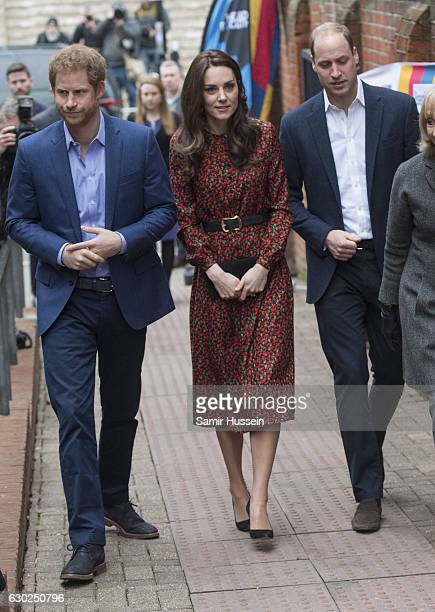 Catherine Duchess of Cambridge Prince Harry and Prince William Duke of Cambridge attend a Christmas party for volunteers at The Mix youth service on...