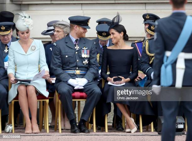 Catherine Duchess of Cambridge Prince Harry Duke of Sussex and Meghan Duchess of Sussex during the RAF 100 ceremony at Buckingham Palace as members...
