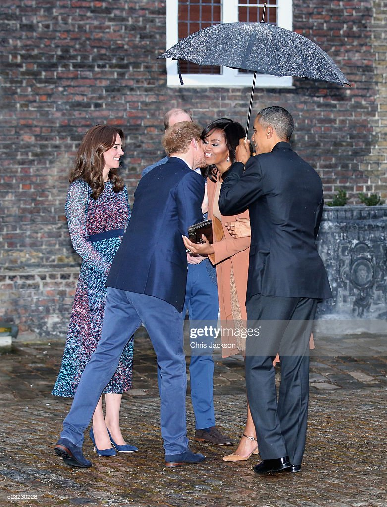 Catherine, Duchess of Cambridge, Prince Harry, First Lady Michelle Obama and US President Barack Obama greet each other as they attend a dinner at Kensington Palace on April 22, 2016 in London, England.