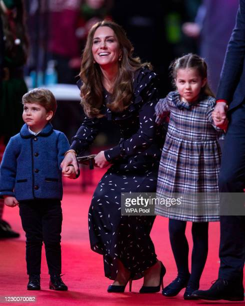 Catherine, Duchess of Cambridge, Prince Louis and Princess Charlotte attend a special pantomime performance at London's Palladium Theatre, hosted by...
