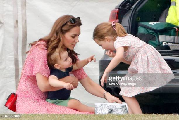 Catherine, Duchess of Cambridge, Prince Louis of Cambridge and Princess Charlotte of Cambridge attend the King Power Royal Charity Polo Match, in...