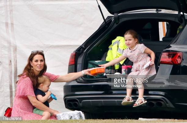 Catherine Duchess of Cambridge Prince Louis of Cambridge and Princess Charlotte of Cambridge attend the King Power Royal Charity Polo Match in which...