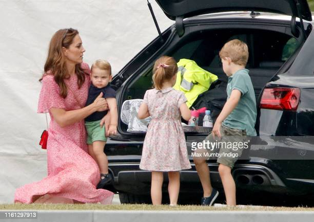 Catherine, Duchess of Cambridge, Prince Louis of Cambridge, Princess Charlotte of Cambridge and Prince George of Cambridge attend the King Power...