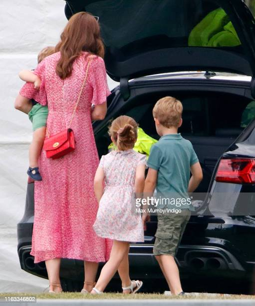 Catherine Duchess of Cambridge Prince Louis of Cambridge Princess Charlotte of Cambridge and Prince George of Cambridge attend the King Power Royal...