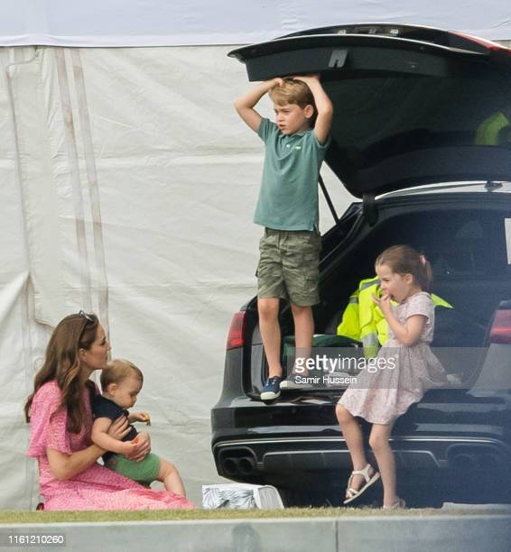 Catherine, Duchess of Cambridge, Prince Louis, Prince George and Princess Charlotte attend The King Power Royal Charity Polo Day at Billingbear Polo...