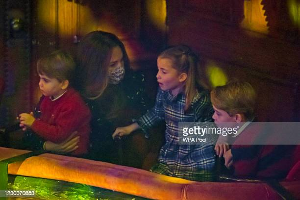 Catherine, Duchess of Cambridge, Prince Louis, Princess Charlotte and Prince George attend a special pantomime performance at London's Palladium...