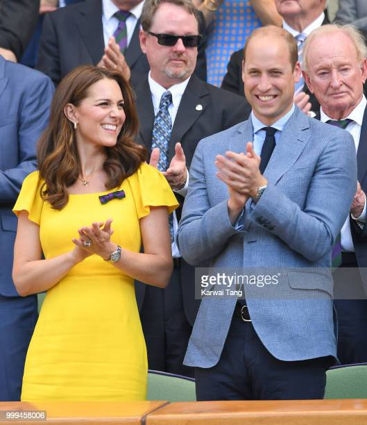 Catherine Duchess of Cambridge Prince William and Duke of Cambridge applaud during the men's singles final on day thirteen of the Wimbledon Tennis...