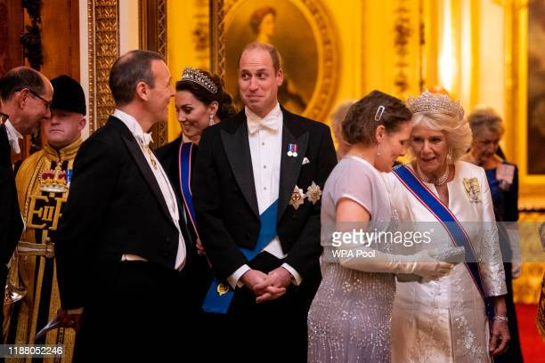 Catherine, Duchess of Cambridge, Prince William, and the Duchess of Cornwall at an evening reception for members of the Diplomatic Corps at...