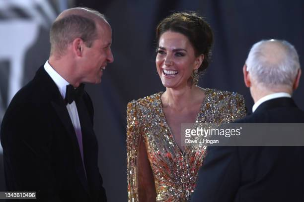 "Catherine, Duchess of Cambridge, Prince William, Duke of Cambridge, Barbara Broccoli and Michael G. Wilson attend the ""No Time To Die"" World Premiere..."