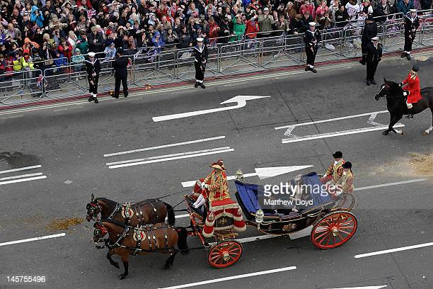 Catherine Duchess of Cambridge Prince William Duke of Cambridge and Prince Harry travel by carriage along Parliament Street to Buckingham Palace...