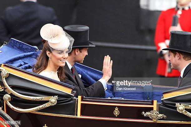 Catherine Duchess of Cambridge Prince William Duke of Cambridge and Prince Harry are seen during the Diamond Jubilee carriage procession after the...