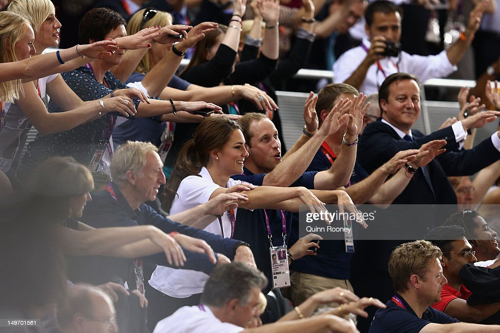 Catherine, Duchess of Cambridge, Prince William, Duke of Cambridge and Prime Minister David Cameron take part in a Mexican wave as they watch the track cycling on Day 6 of the London 2012 Olympic Games at Velodrome on August 2, 2012 in London, England.