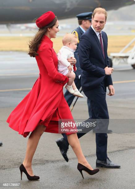 Catherine, Duchess of Cambridge, Prince William, Duke of Cambridge and Prince George of Cambridge arrive at Wellington Military Terminal on an RNZAF...