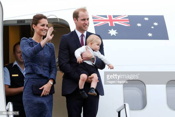 Catherine, Duchess of Cambridge, Prince William, Duke of Cambridge and Prince George of Cambridge wave to the crowd before boarding a Royal...
