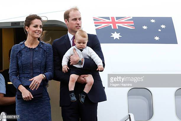 Catherine, Duchess of Cambridge, Prince William, Duke of Cambridge and Prince George of Cambridge look on before boarding a Royal Australian Air...