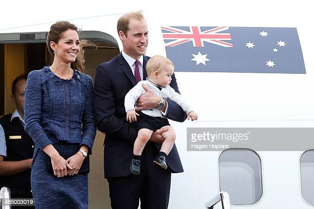Catherine Duchess of Cambridge Prince William Duke of Cambridge and Prince George of Cambridge look on before boarding a Royal Australian Air Force...