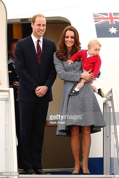 Catherine, Duchess of Cambridge, Prince William, Duke of Cambridge and Prince George of Cambridge leave Fairbairne Airbase as they head back to the...