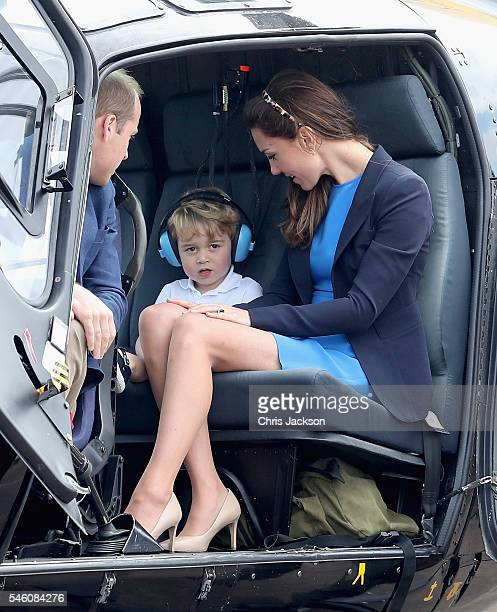 Catherine Duchess of Cambridge Prince William Duke of Cambridge and Prince George sit in a Squirrel helicopter during a visit to the Royal...