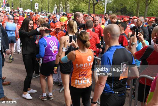 Catherine, Duchess of Cambridge, Prince William, Duke of Cambridge and Prince Harry give out medals to the finishers of the 2017 Virgin Money London...
