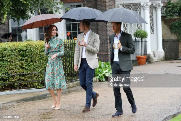 Catherine Duchess of Cambridge Prince William Duke of Cambridge and Prince Harry are seen during a visit to The Sunken Garden at Kensington Palace on...