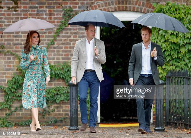 Catherine, Duchess of Cambridge, Prince William, Duke of Cambridge and Prince Harry visit the Sunken Garden in the grounds of Kensington Palace on...