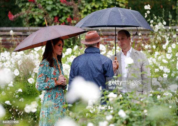 Catherine, Duchess of Cambridge, Prince William, Duke of Cambridge are seen during a visit to The Sunken Garden at Kensington Palace on August 30,...