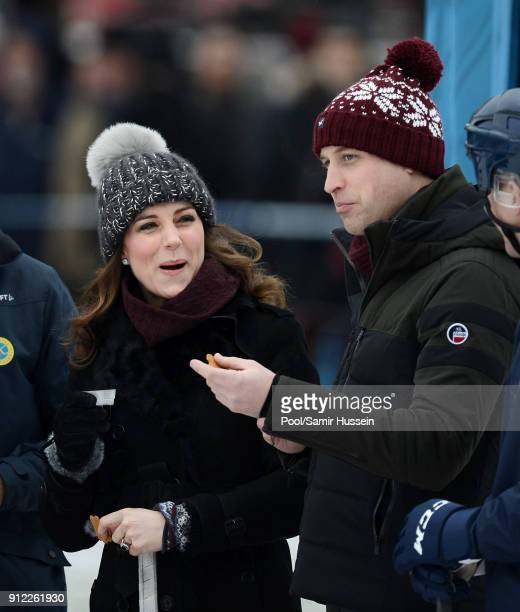 Catherine Duchess of Cambridge Prince William Duke of Cambridge have a drink and a biscuit as they attend a Bandy hockey match where they will learn...