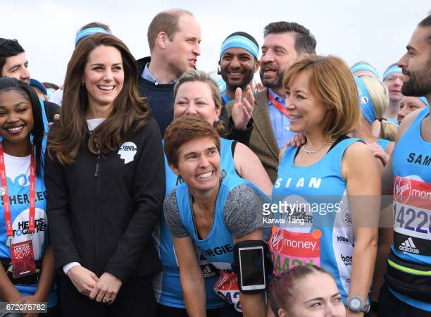 Catherine Duchess of Cambridge Prince William Duke of Cambridge Nick Knowles and Sian WIlliams meet Heads Together runners in the Blue Start area as...