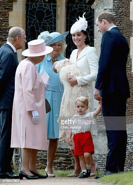 Catherine, Duchess of Cambridge, Prince William, Duke of Cambridge, Princess Charlotte of Cambridge and Prince George of Cambridge talk to Queen...