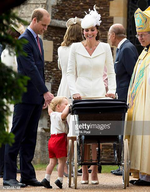 Catherine, Duchess of Cambridge, Prince William, Duke of Cambridge, Princess Charlotte of Cambridge and Prince George of Cambridge speak with...