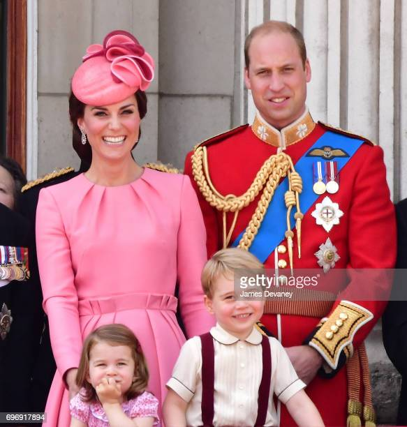 Catherine Duchess of Cambridge Prince William Duke of Cambridge Princess Charlotte of Cambridge and Prince George of Cambridge stand on the balcony...